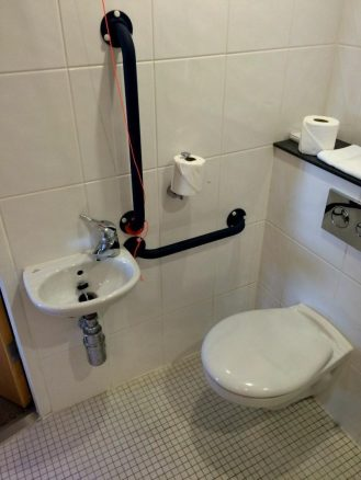 Toilet with Grab Rails