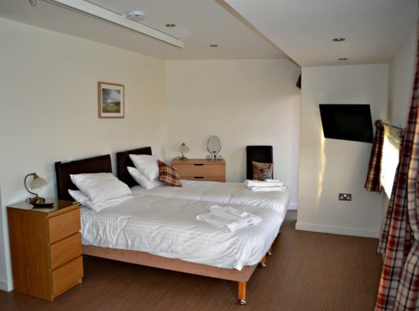 Bedroom in Cottage with a Ceiling Hoist
