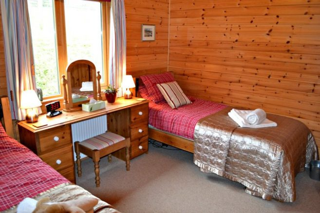 Twin Profiling Beds in Log Cabin