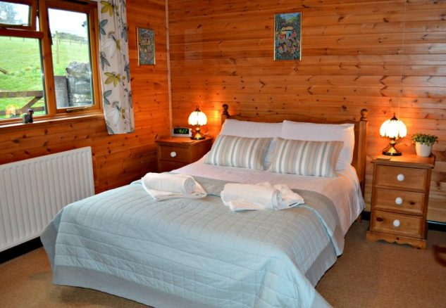 Luxury Bedroom in Hoe Grange Holidays Log Cabin